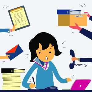 Very busy business woman working hard on her desk in office with a lot of paper work, talking on smart phone, and more tasks coming to her. Business concept on hard working.